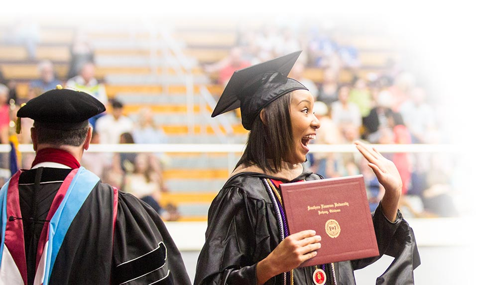 Woman excited after receiving diploma